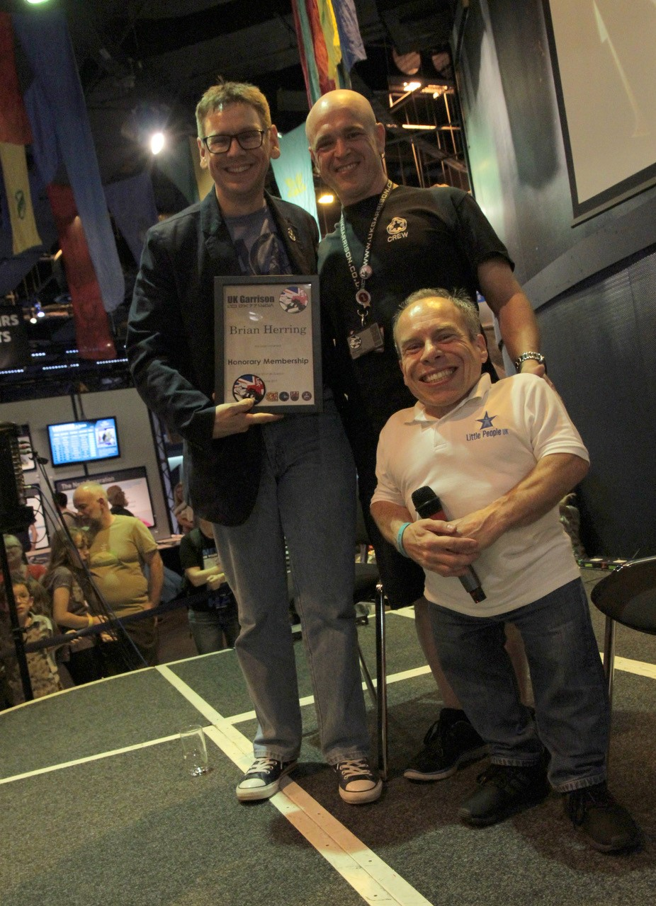 Brian Herring being presented with his Honorary Member by UKG CO Gary Hailes and Star Wars Actor Warwick Davis