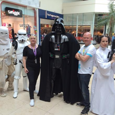 Bunny Rajput, from Festival Place, and Mark Jones, director of fundraising and communications for Ark Cancer Centre Charity, with the members of the UK Garrison