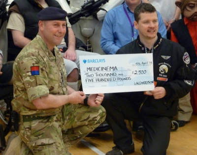 UK Garrison presenting a cheque to MediCinema on a visit to the Defense Medical Rehabilitation Centre Headley Court